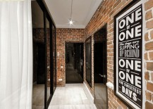 Brick-walls-and-dark-glass-doors-shape-the-entrance-217x155