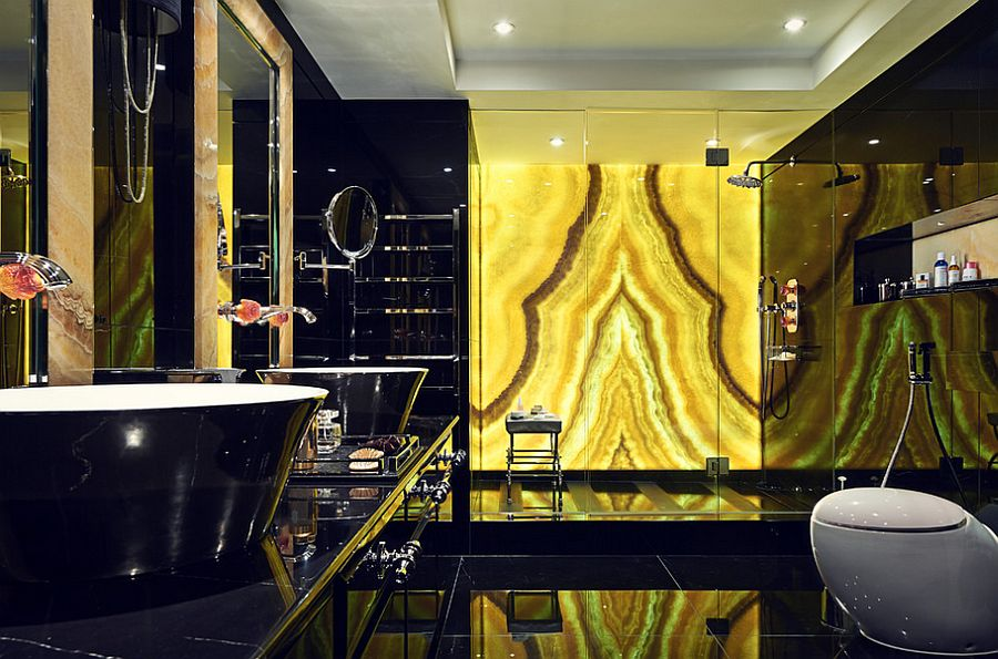Brilliantly backlit onyx in the bathroom adds gold to the dark space [From: Marco Joe Fazio]