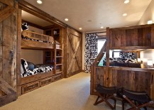 Bunk beds and sliding barn doors in the rustic bedroom