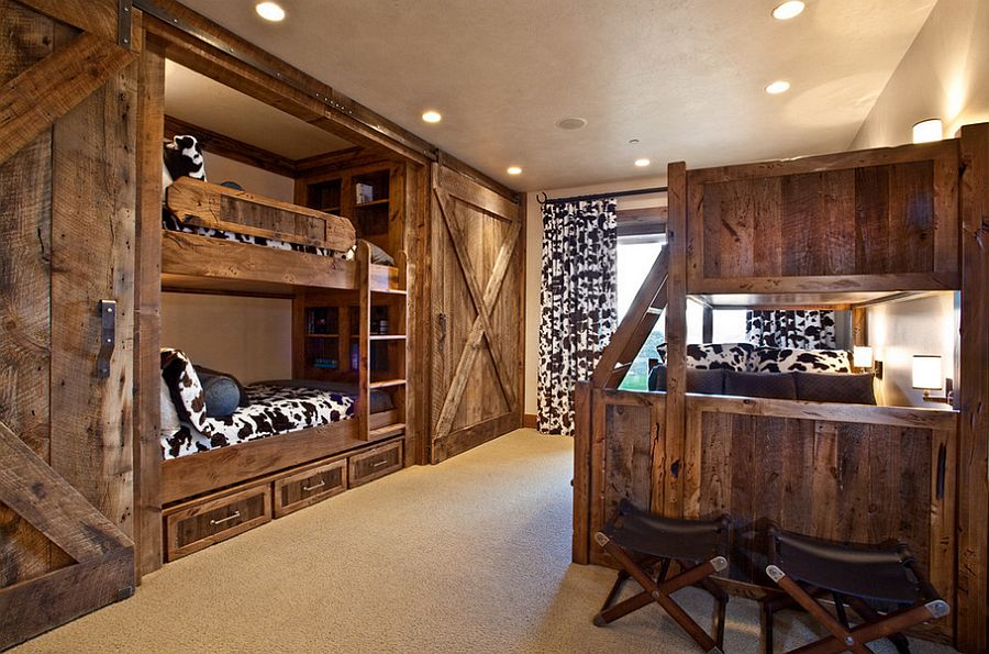 Bunk beds and sliding barn doors in the rustic bedroom [Design: MHR Design]