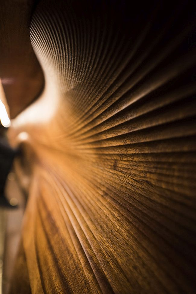 CNC'd mahogany turns the bar walls into works of art
