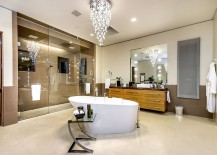 Cascading chandelier above the bathtub steals the show