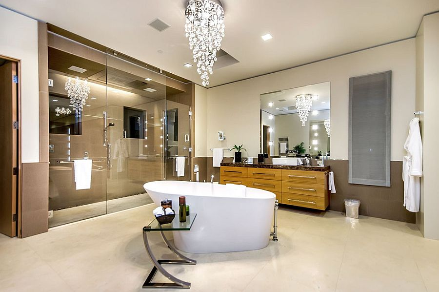 25 sparkling ways of adding a chandelier to your dream bathroom view in gallery cascading chandelier above the bathtub steals the show photography mark pinkerton vi360 aloadofball Image collections