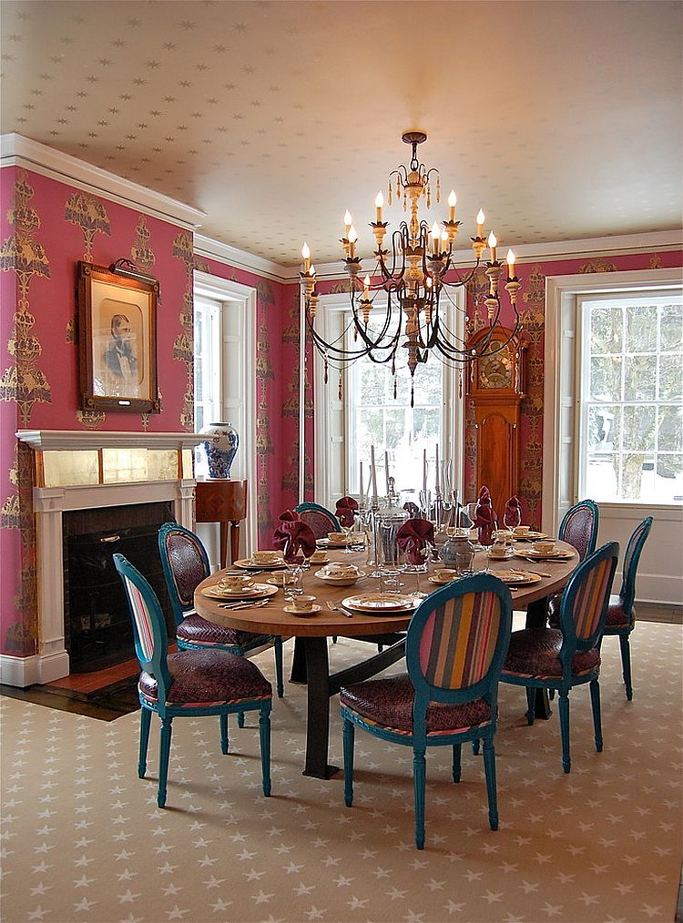Ceiling wallpaper enhances the luxurious look of the dining room [Design: Favreau Design]