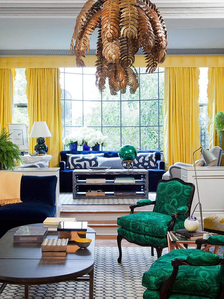 Chairs covered in malachite fabric steal the show in this eclectic living room [Design: Amanda Nisbet Design]