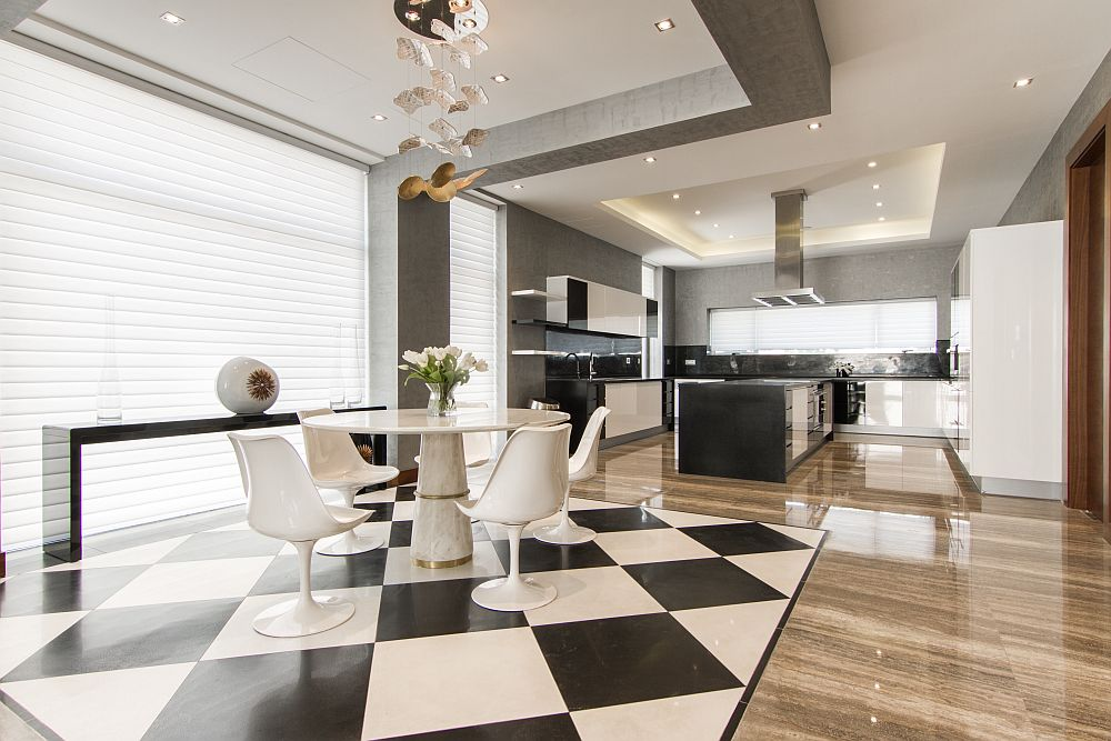Checkered tiles separate the dining space from the kitchen