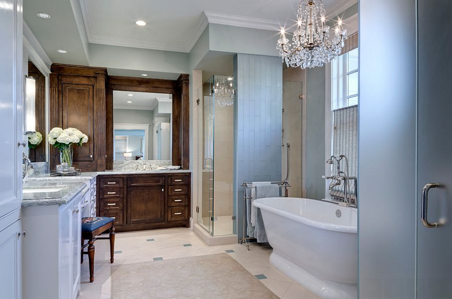 Classic glass chandelier shines in the traditional bathroom [Design: Domiteaux + Baggett Architects]