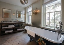 Claw-foot bathtub in gray for the industrial bathroom