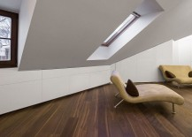Cleverly concealed shelves in the tiny attic apartment that disappear into the walls