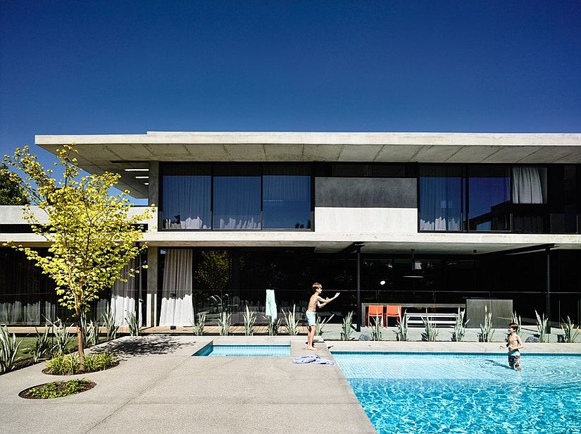 Concrete connects the interior with the pool deck outside texturally