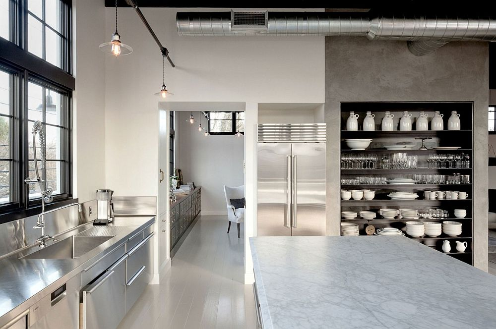 Concrete, steel and glass shape the large kitchen of the house