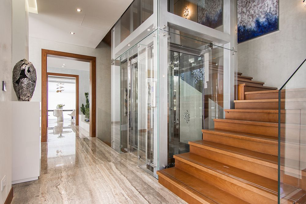 Contemporary elevator connects the various levels of the home
