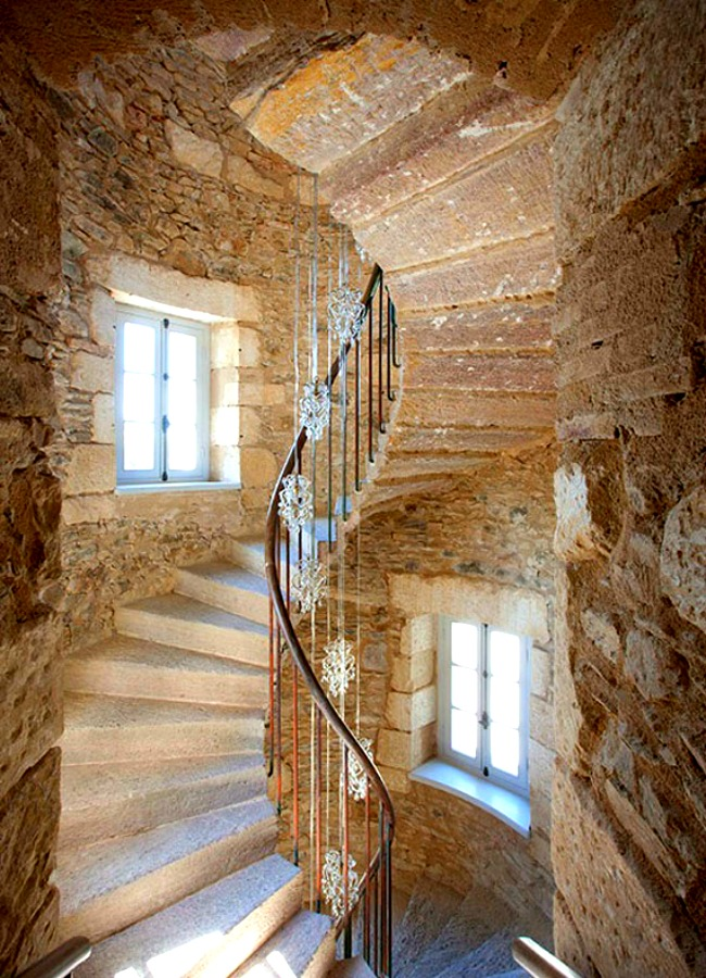 A classic stairway between two stories of a stone cottage