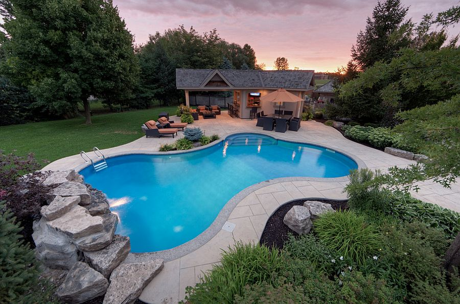 Custom stamped concrete deck complements the colors of the house [Design: Betz Pools Limited]