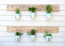 DIY herb garden with pallet wood and paint cans