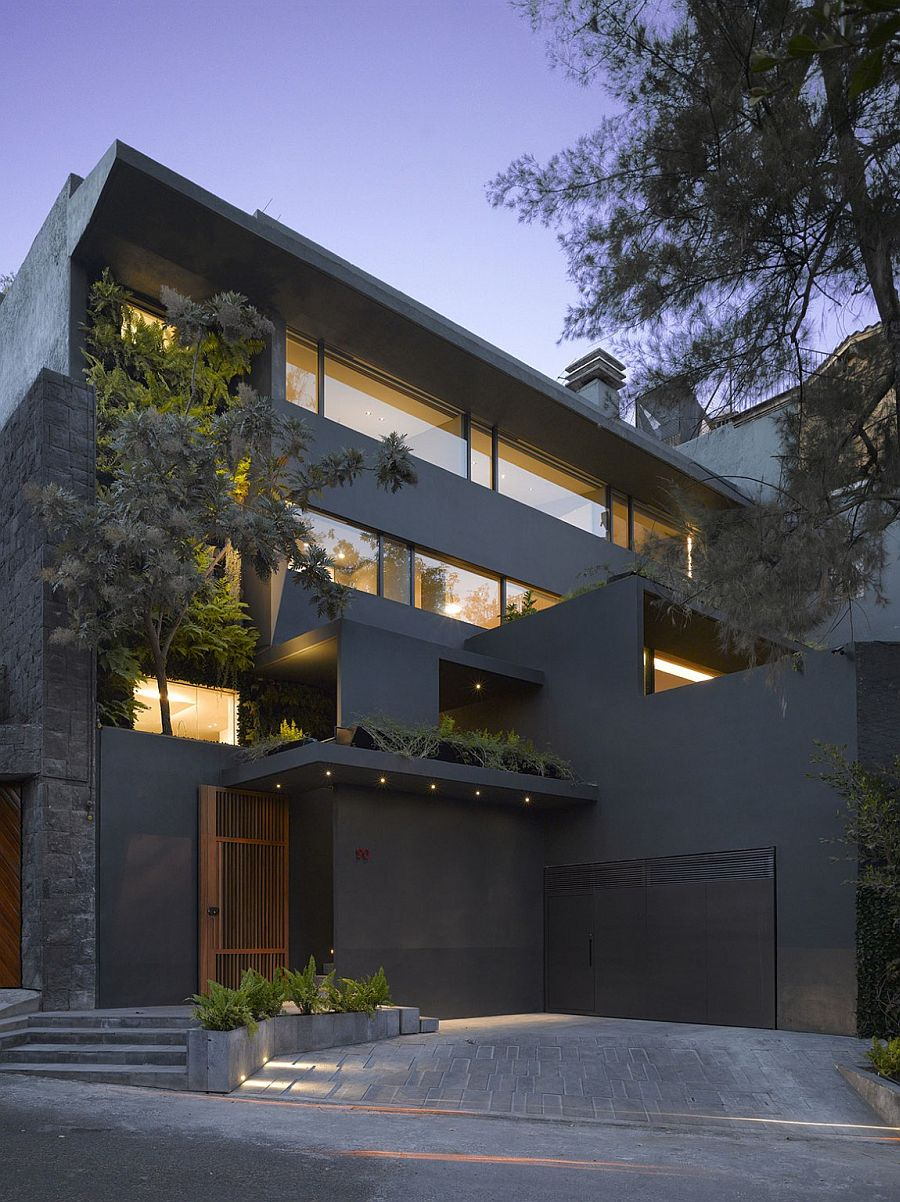 Dark exterior seems to blend into the natural backdrop beautifully