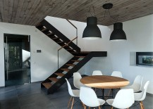 Dark-industrial-style-lighting-above-the-small-dining-area-217x155