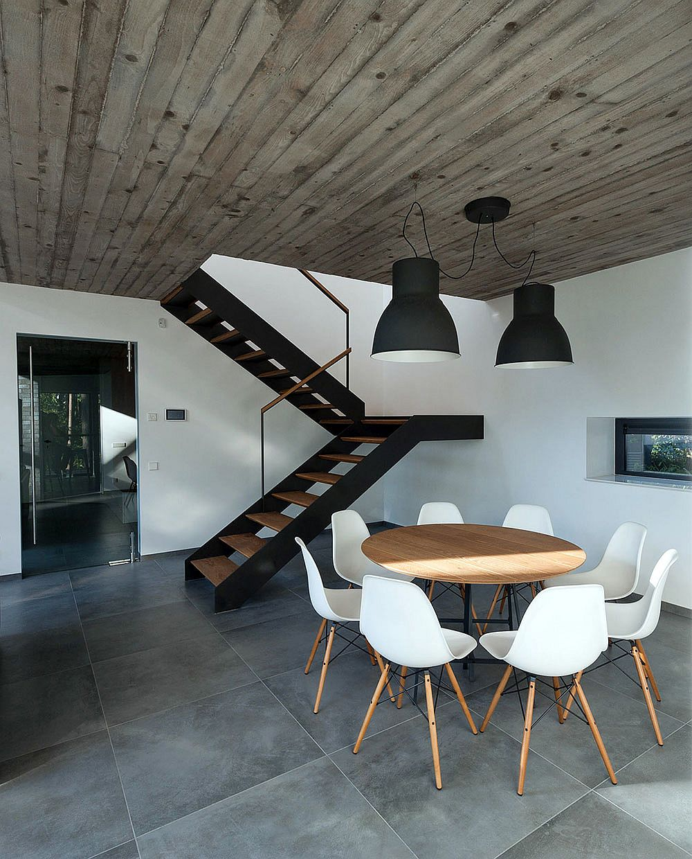 Dark industrial style lighting above the small dining area