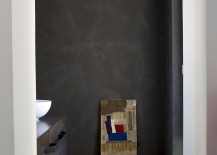 Dark wall in the bathroom gives the space a sober look