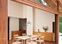 Dining-area-of-the-renovated-residence-with-a-view-of-the-pond-and-the-landscape-outside-217x155