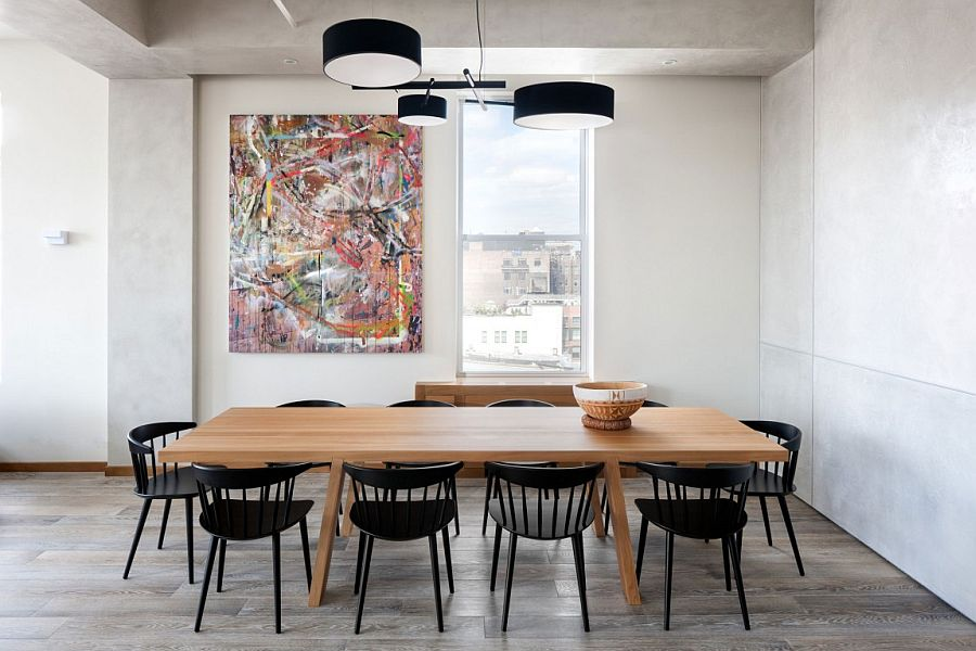 Dining area with minimal wall art and black dining table chairs
