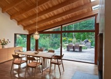 Dining-room-with-a-view-of-the-garden-deck-and-the-pond-217x155
