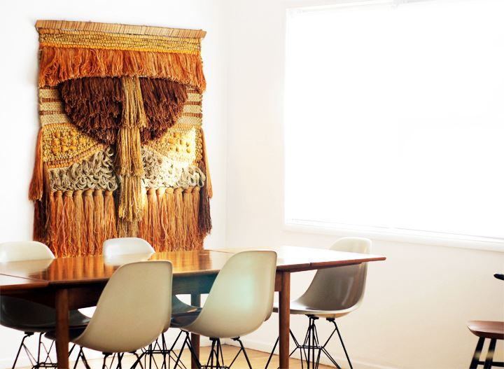 Dining room with hanging fiber art