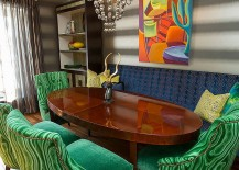 Dining table chairs add emerald green to the setting
