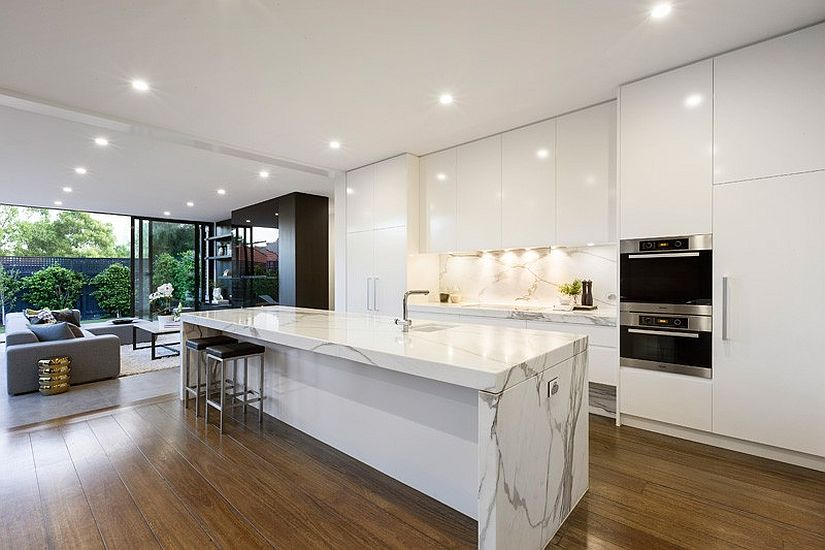 Dramatic marble island bench is the showstopper in the white kitchen