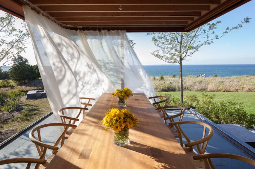 Dramatic outdoor dining area with an ocean view