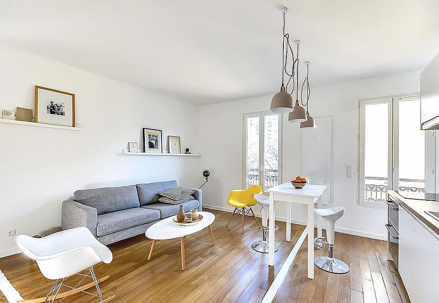 Eames chair adds a touch of yellow to the living area 30sqm Paris Apartment Unravels a World of Space Saving Delights!