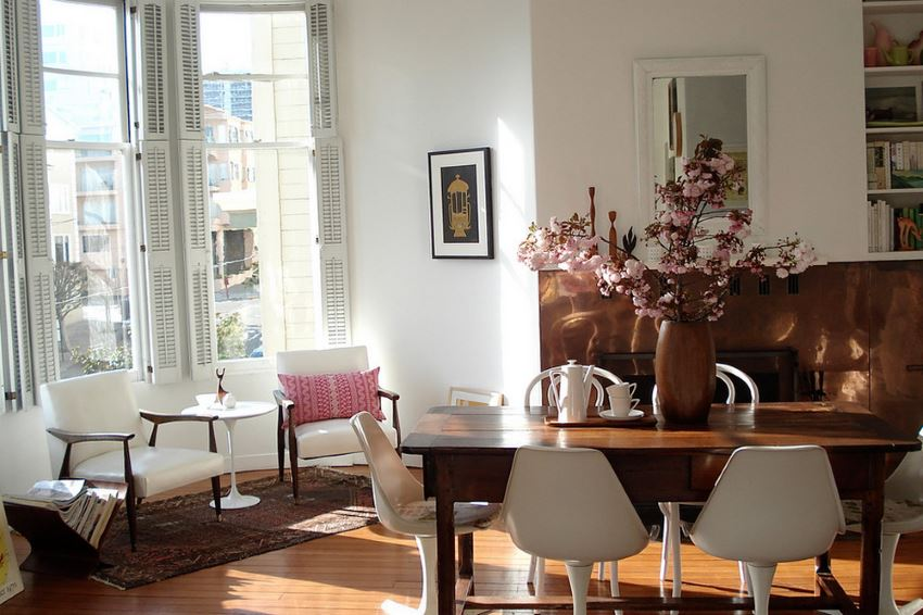 Eclectic dining room with pink blossoms
