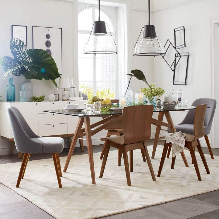 Eclectic dining room with tropical leaves