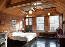 Elegant bedroom with gabled ceiling and brick walls