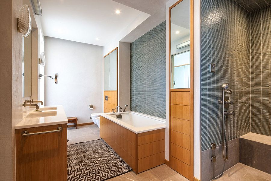 Elegant use of wood adds warmth to the modern New York bathroom