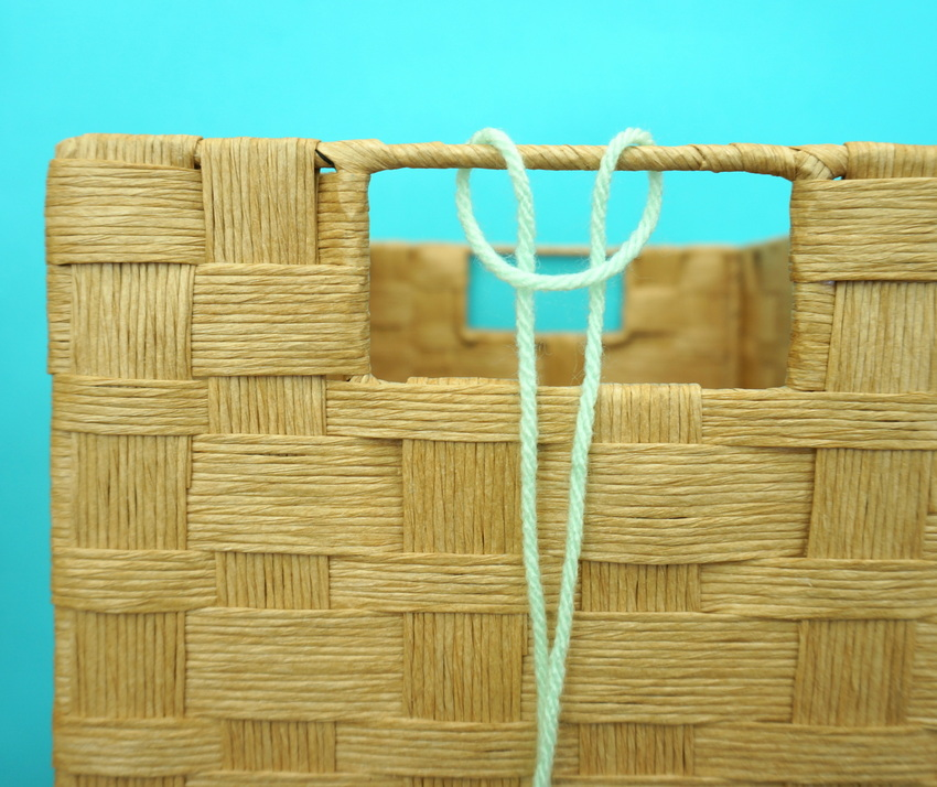Embellish your gift basket handles with yarn