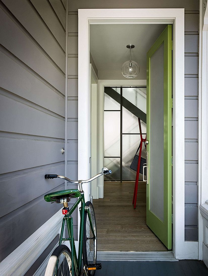 Entrance to the renovated San Francisco home with a trendy green door