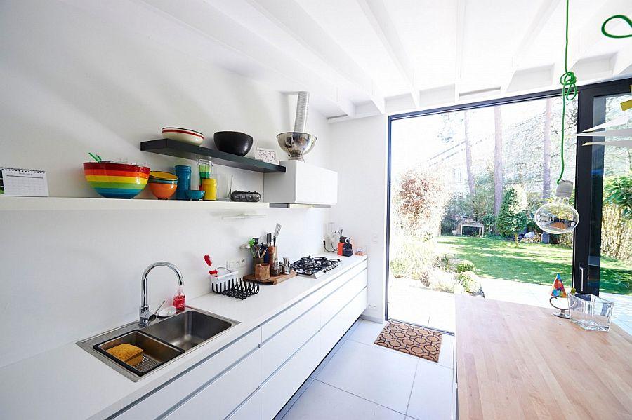 Eronomic kitchen workstation design with floating shelves above