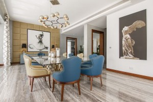 Exclusive dining area with brilliant wall art and custom lighting fixtures