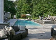 Expansive pool area with a stamped concrete deck