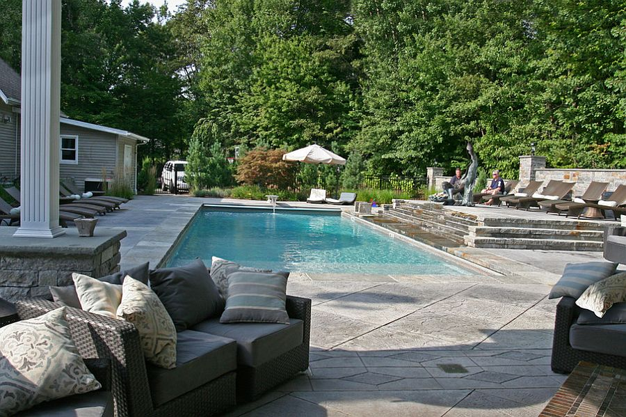 Expansive pool area with a stamped concrete deck [Design: L. M. Scofield Company]