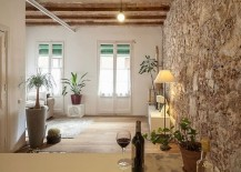 Exposed-stone-wall-of-the-original-structure-adds-uniqueness-to-the-home-217x155