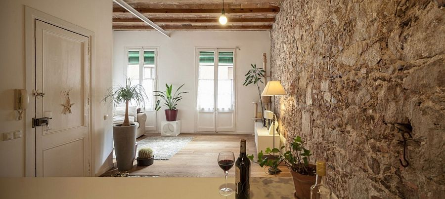 Exposed stone wall of the original structure adds uniqueness to the home