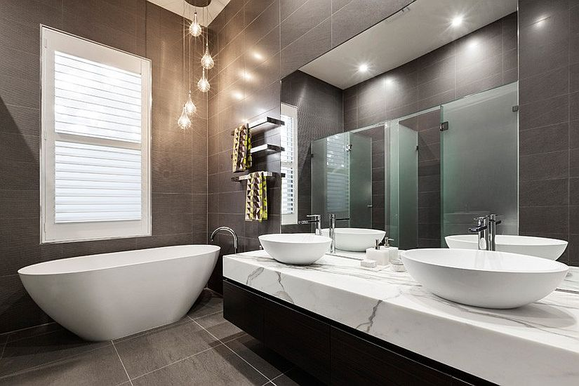 Exquisite contemporary bathroom in gray with standalone bathtub in white