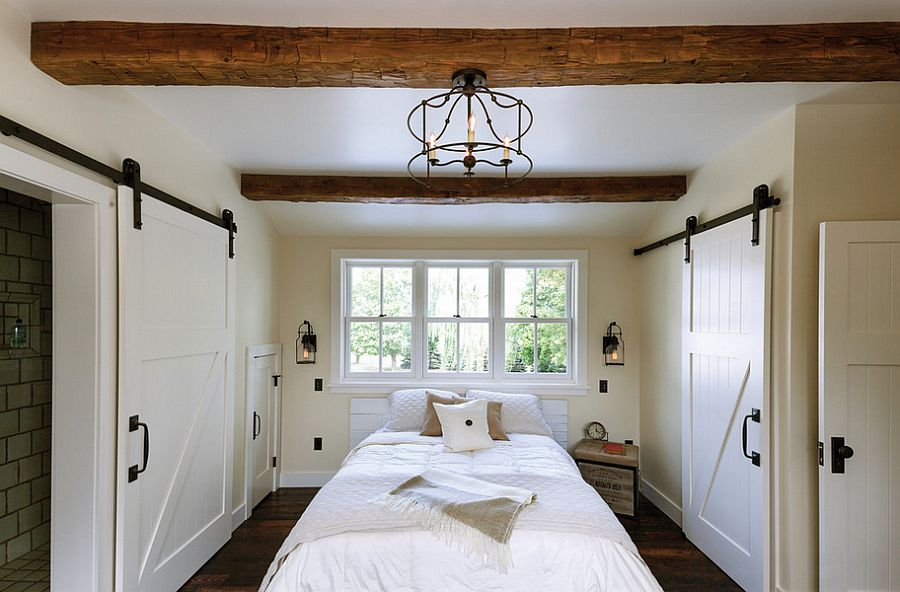 Exquisite use of sliding barn doors in the bedroom [From: Jeffrey Lendrum / Lendrum Photography]