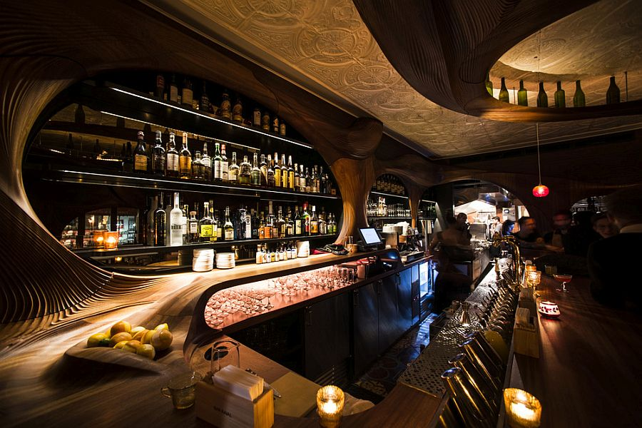 Exquisite wooden detailing and sensational lighting shape the interior of the bar