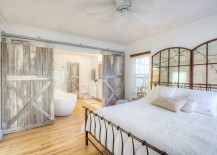 Farmhouse style bedroom with reclaimed wood barn doors
