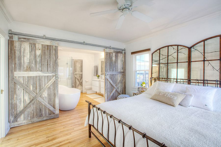 25 bedrooms that showcase the beauty of sliding barn doors for Farmhouse style bed