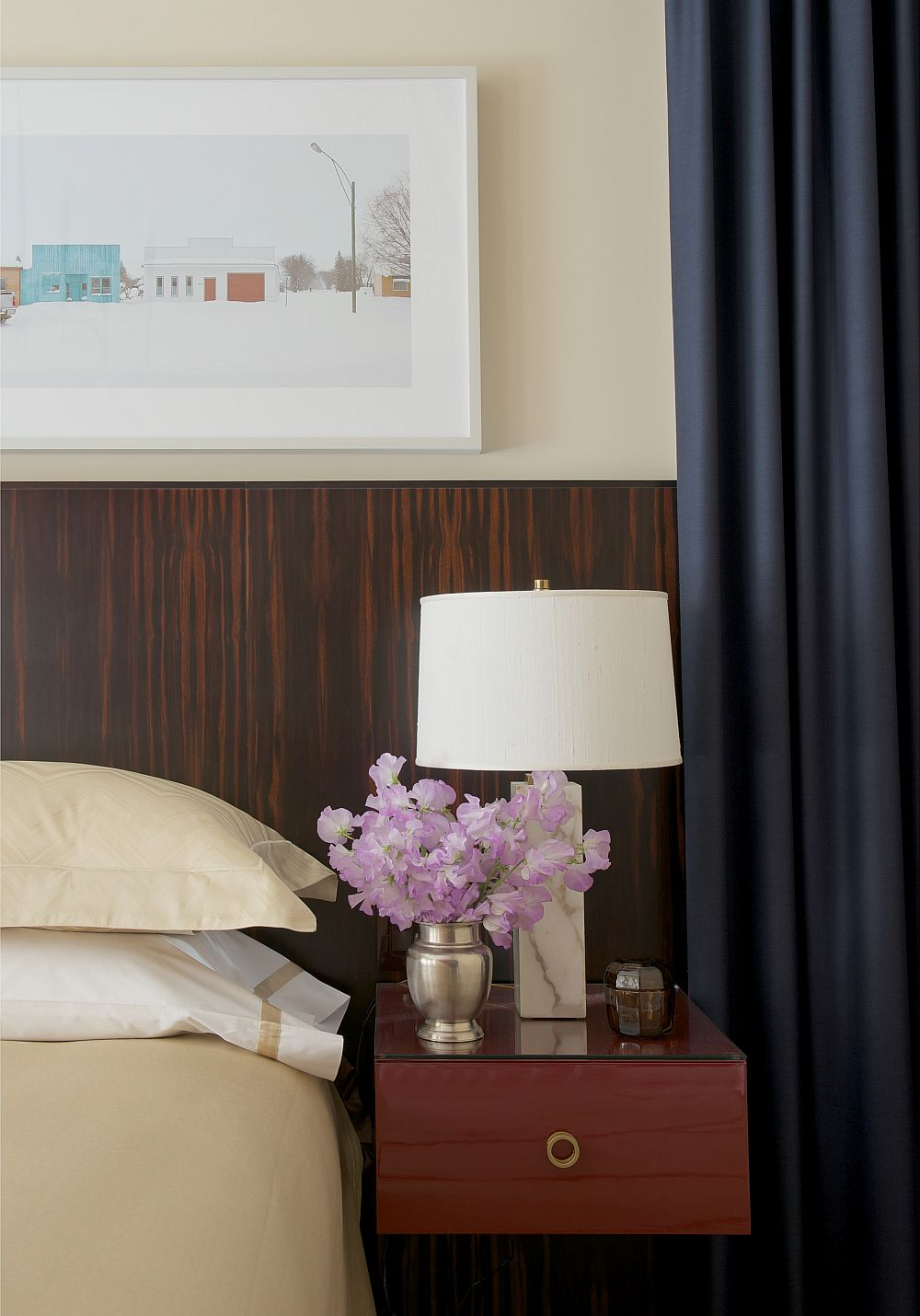 Floating bedside table design with a cool lamp