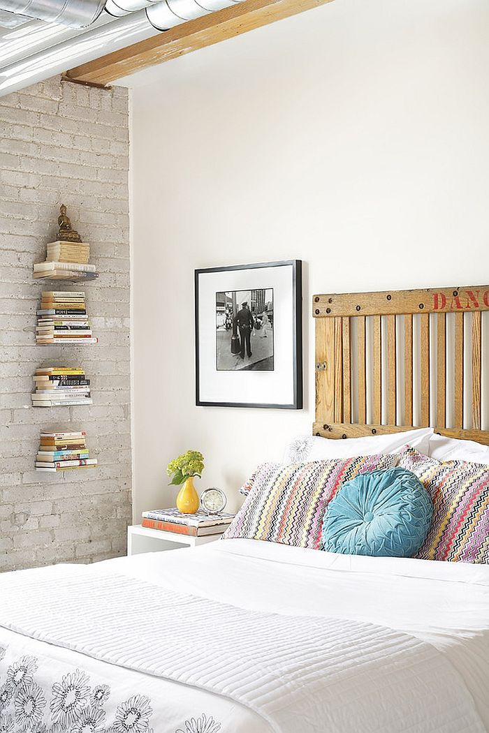 Freight elevator door turned into a smart headboard in the industrial bedroom [Photography: Aristea Rizakos]